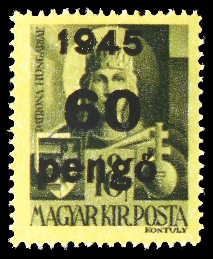 Virgin Mary, Patroness of Hungary, Surcharged serie, circa 1945. MOSCOW, RUSSIA - JULY 19, 2019: Postage stamp printed in Hungary shows Virgin Mary, Patroness of royalty free stock image