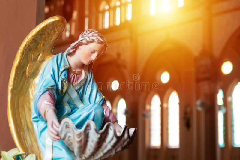 The Virgin Mary statue in church with sun light from top window, christian religion. The Virgin Mary statue in church with sun light from top window, christian royalty free stock photo