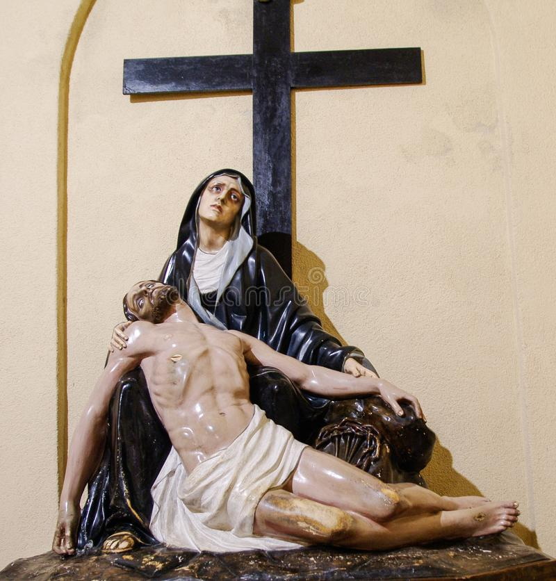 Sardinia. Faith and Art. Representation of Pietà: the Virgin Mary mourns the dead Christ.  Sanctuary of Nostra Signora di Bonaria. The Virgin Mary under cross stock photography
