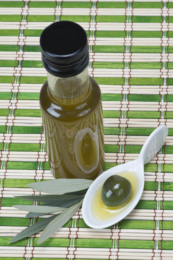 Virgin olive oil on a bamboo mat royalty free stock photos