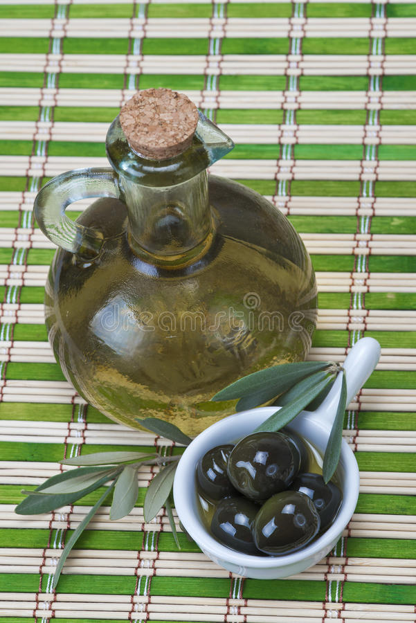 Download Virgin Olive Oil On A Bamboo Mat Stock Image - Image: 27454937