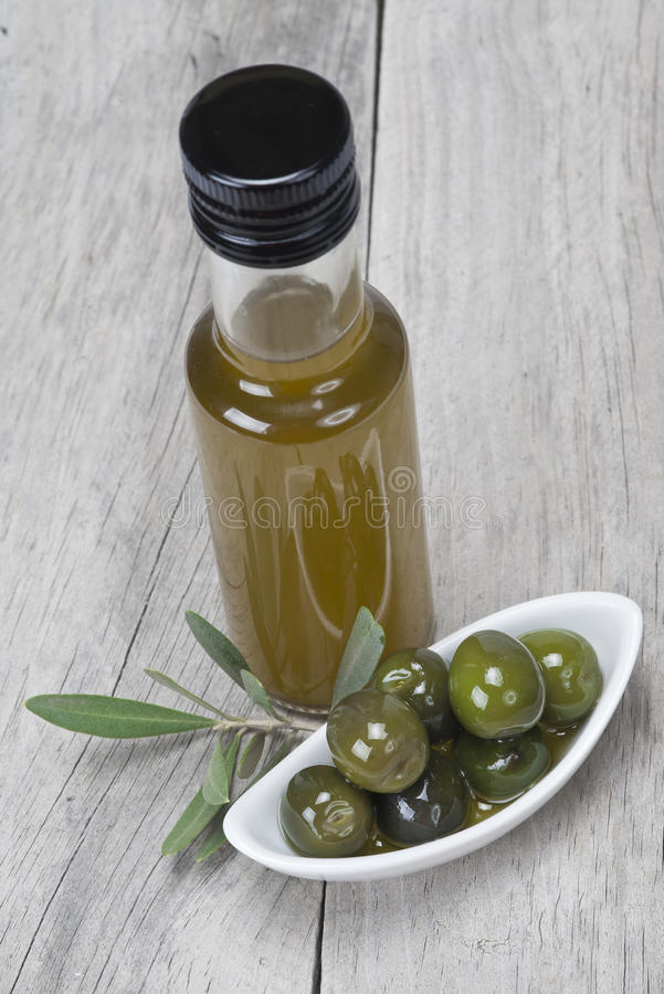 Virgin olive oil and green olives stock photo