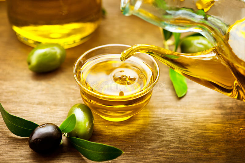Virgin olive oil pouring royalty free stock photography