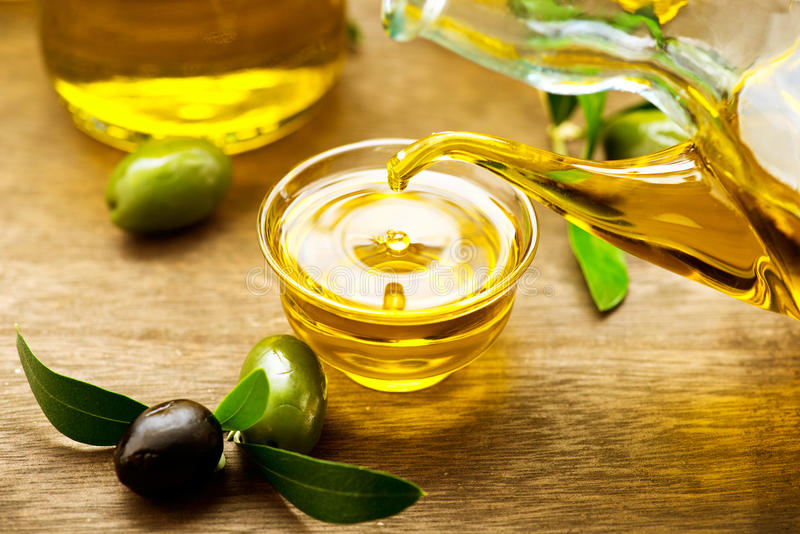 Virgin olive oil pouring stock photo