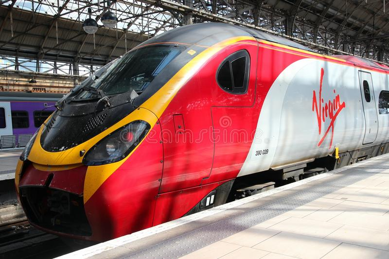 Virgin Trains. MANCHESTER, UK - APRIL 23: Virgin Trains Pendolino train on April 23, 2013 in Manchester, UK. Virgin Trains operates since 1997 and as of 2013 royalty free stock image
