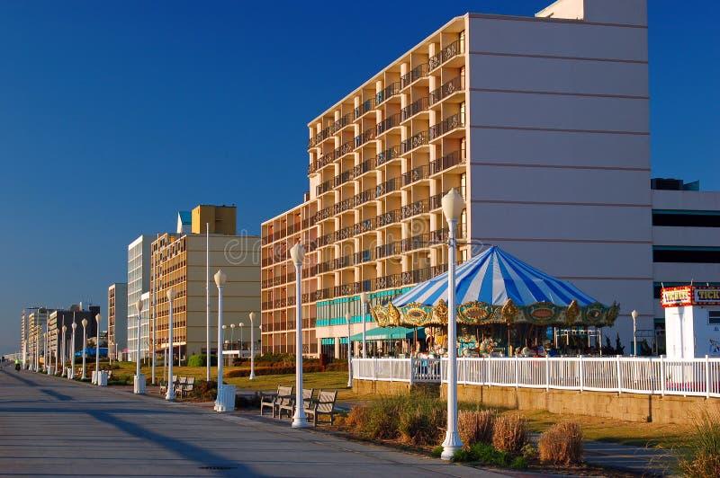 Virginia Beach Boardwalk. Hotels and a carousel line the Virginia Beach Boardwalk royalty free stock image