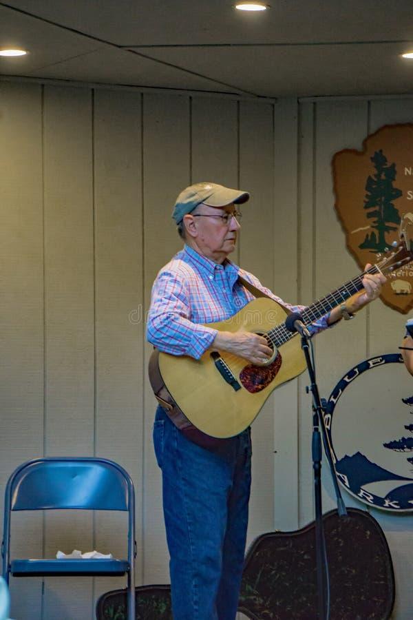 Virginia Carolina playing a Bluegrass Music on a Guitar. Roanoke County, VA, August 18th, 2019: Virginia Carolina playing Bluegrass Music on a guitar at the royalty free stock photography