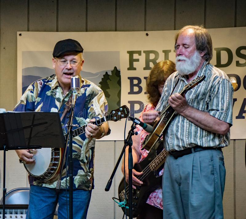 Virginia Carolina Singing and Playing Bluegrass Music. Roanoke County, VA, August 18th, 2019: Virginia Carolina playing Bluegrass Music at the Roanoke Mountain stock photography
