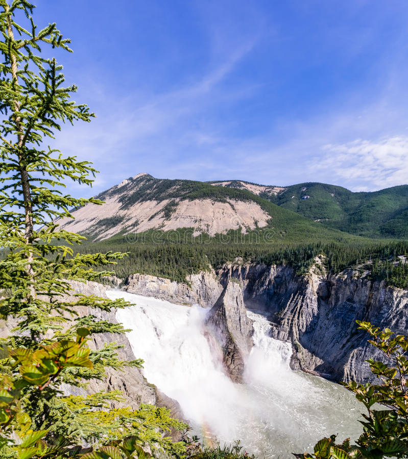 Virginia Falls - South Nahanni river, Canada. 96 m drop of Virginia Falls - South Nahanni river, Northwest Territories, Canada with small rainbow royalty free stock images