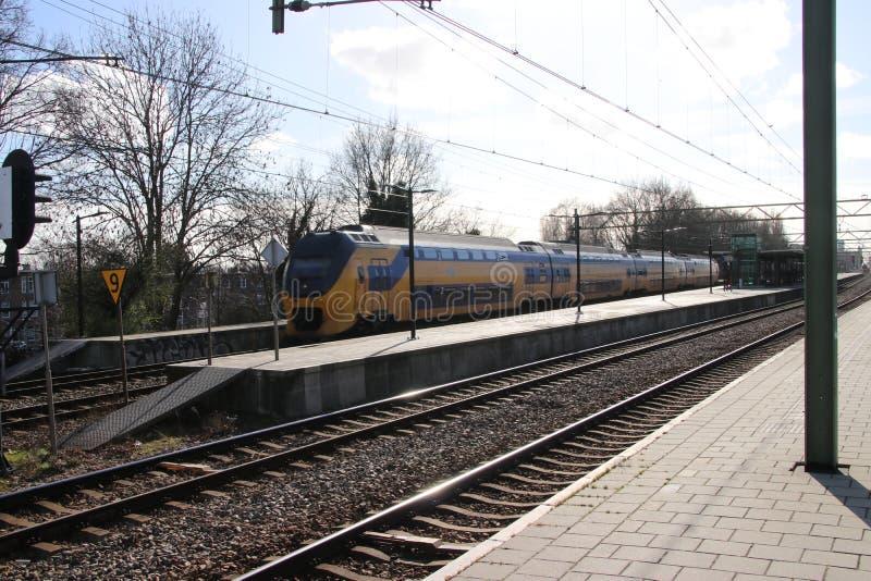 VIRM intercity double decker train at the trainstation of Den Haag Laan van NOI in the Netherlands stock photos