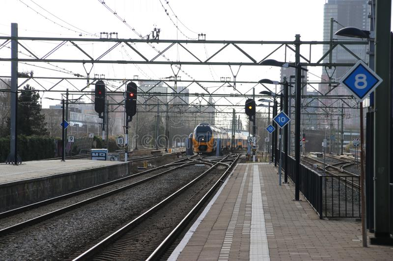 VIRM intercity double decker train at the trainstation of Den Haag Laan van NOI in the Netherlands. stock image
