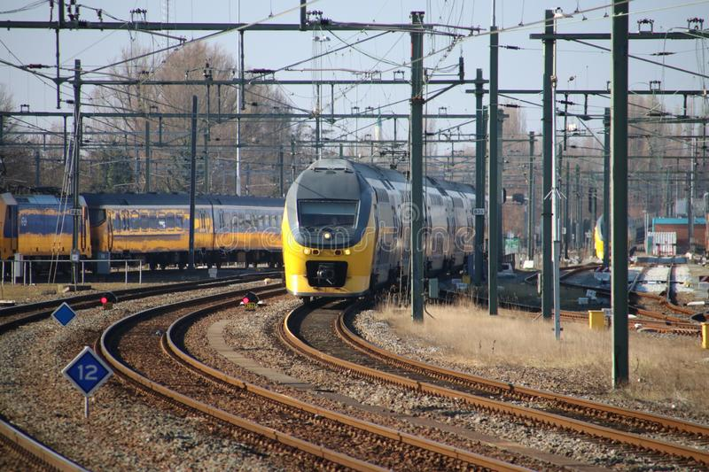 VIRM Talbot intercity is arriving along the platform at Rotterdam Central Station in the Netherlands. royalty free stock photos
