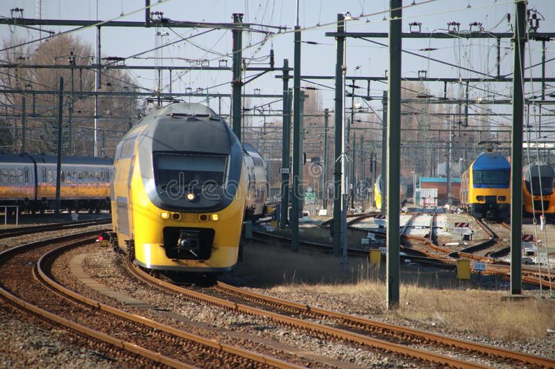 VIRM Talbot intercity is arriving along the platform at Rotterdam Central Station in the Netherlands. stock photos