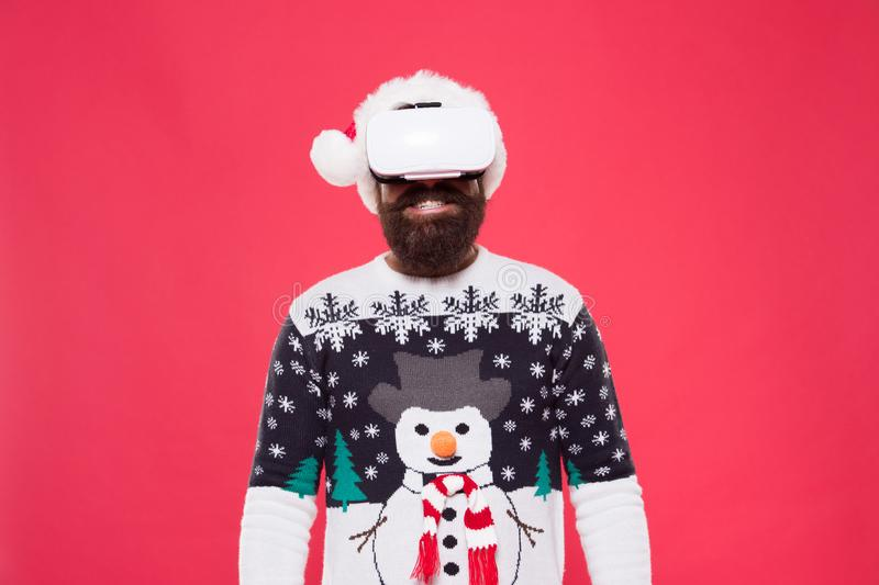 Virtual achievement. Future year. Technologies development. Virtual life. Man celebrate christmas virtual reality device. Gadgets review. Bearded hipster play royalty free stock photo