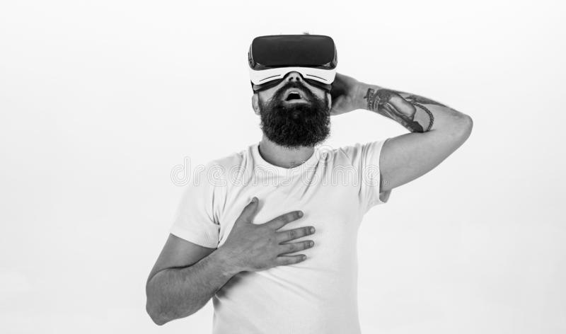Virtual cinema concept. Guy with head mounted display enjoy virtual reality. Man with beard in VR glasses enjoy watching. Video, white background. Hipster on stock images
