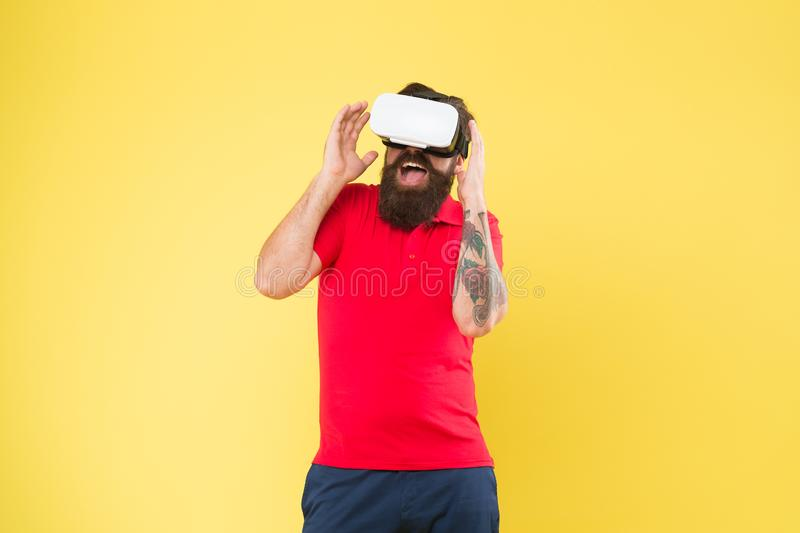 Virtual communication. Virtual simulation. Digital technology. Building your visions. Creating reality. Man play game in. VR glasses. Hipster with virtual stock photography