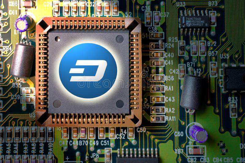 Cryptocurrency and blockchain - financial technology and internet money - circuit board mining and coin DASH stock photo