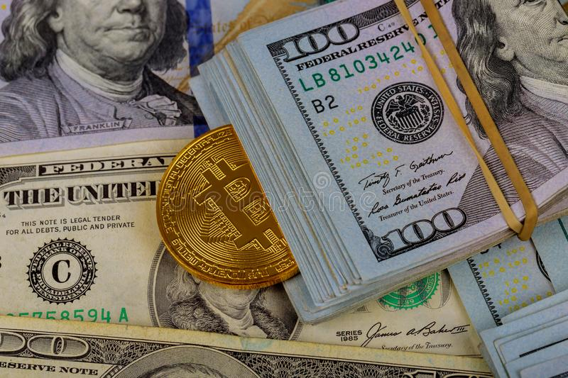 Virtual cryptocurrency money Bitcoin golden coin on United States US dollar bill royalty free stock photo