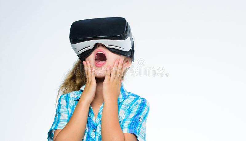Virtual education for school pupil. Get virtual experience. Virtual reality concept. Girl cute child with head mounted. Display on white background. Small kid royalty free stock images