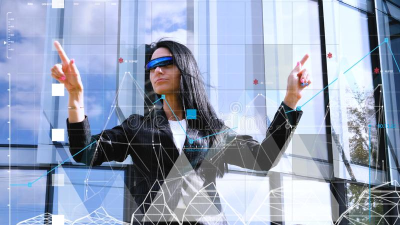 Virtual holographic interface and young woman wearing glasses royalty free stock images
