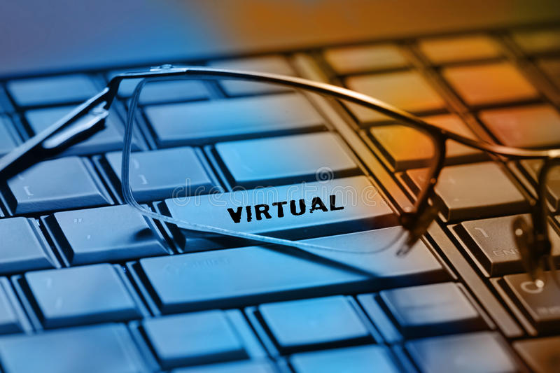 Virtual. On laptop keyboard background stock photography