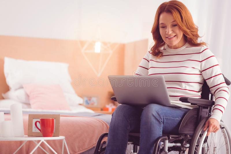 Positive incapacitated woman surfing the net stock photos