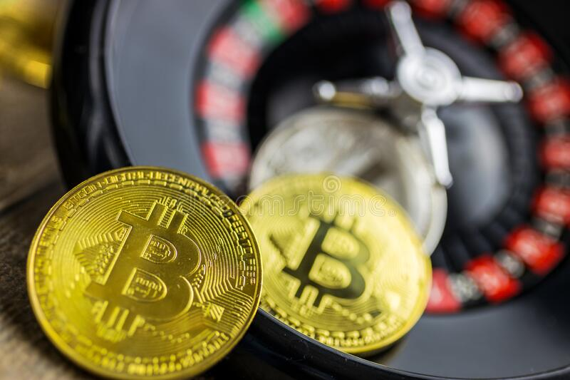 Virtual money Bitcoin BTC cryptocurrency - risky invenstment with the Bitcoins currency - gold coin with a roulette as a symbol of. Risk stock photos