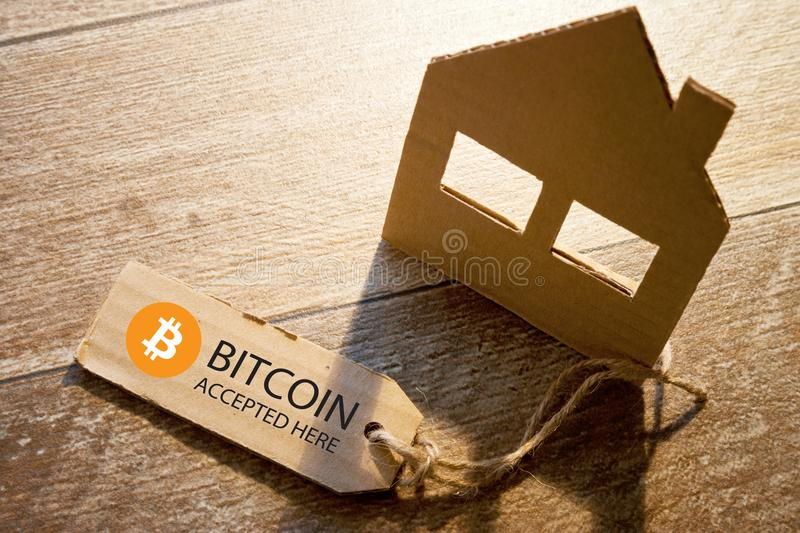 Virtual money Bitcoin cryptocurrency - Bitcoins accepted here. Payment in hotel, restaurant, rental of house and other services stock image