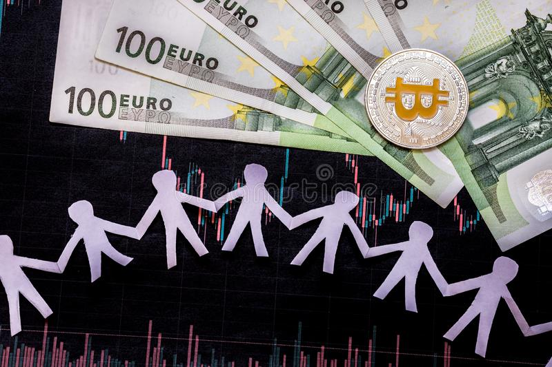 Virtual money golden bitcoin on hundred euro bills and paper forex chart background with paper people. Concept of appreciation of royalty free stock photos