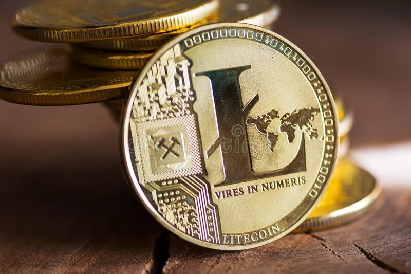 Virtual money Litecoin cryptocurrency - pile of coins and gold LTC coin on the wooden background stock images