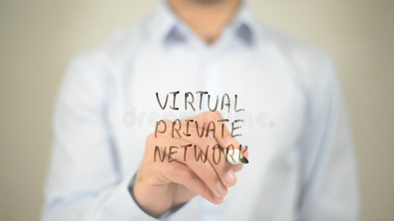 Virtual Private Network, writing on transparent screen. Businessman Writing on Glass Virtual Private Network, writing on transparent screen stock photography