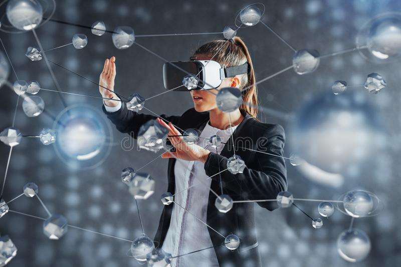 Virtual reality, 3D-technologies, cyberspace, science and people concept - happy woman in 3d glasses touching projection. Molecules on a black background stock photos