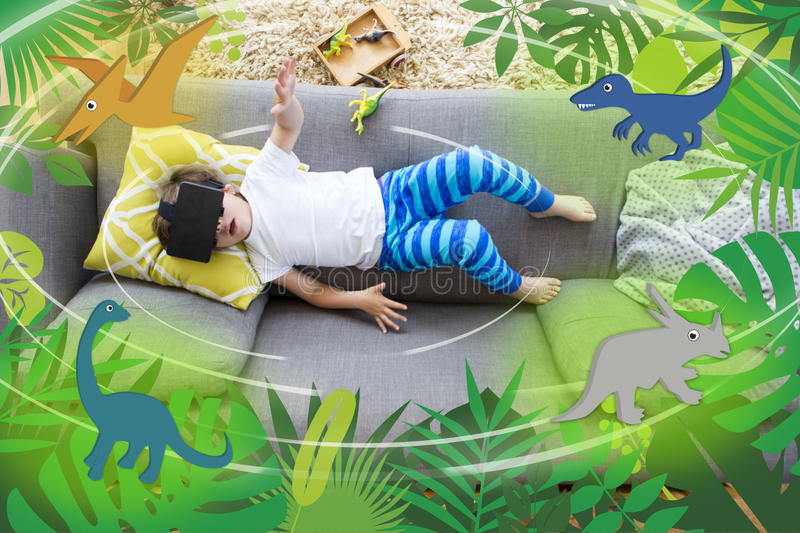 Virtual Reality Dinosaurs. View from above of a little boy lying on his sofa with a box of dinosaurs. He is wearing a VR head set and there are dinosaur graphics vector illustration