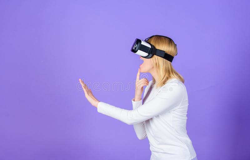 Virtual reality and future technology. Girl use modern technology vr headset. Digital device modern opportunity. Enthralling interaction virtual reality. Woman royalty free stock photography