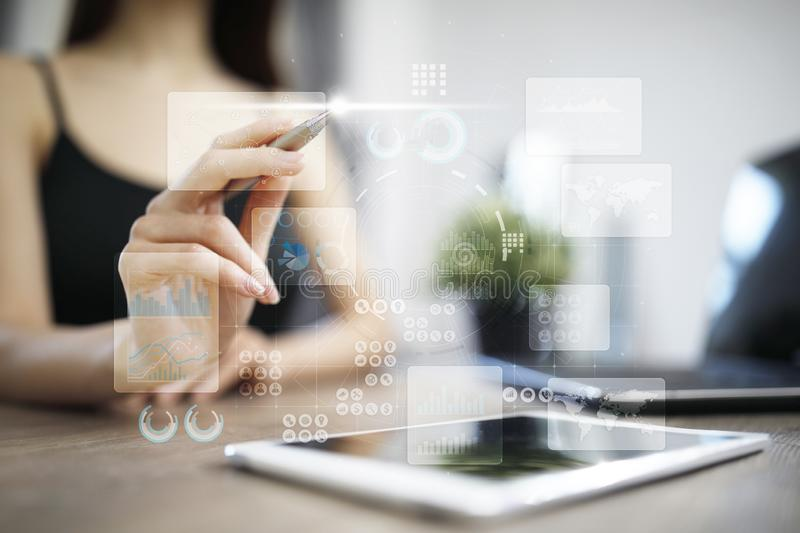 Virtual touch screen. Project management. Data analysis. Hitech technology solutions for business. Development. Icons and graphs background. Internet and royalty free stock photo