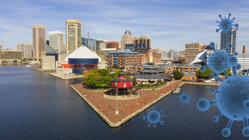 Virus Like Objects Move into the Inner Harbor in Baltimore Maryland. Aerial view of Baltimore during the quarantined from the Covid 19 pandemic royalty free stock images
