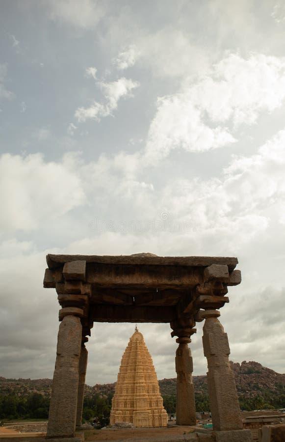 Virupaksha hindu temple gopuram through the Mandapa and ruins, Hampi, India royalty free stock photos