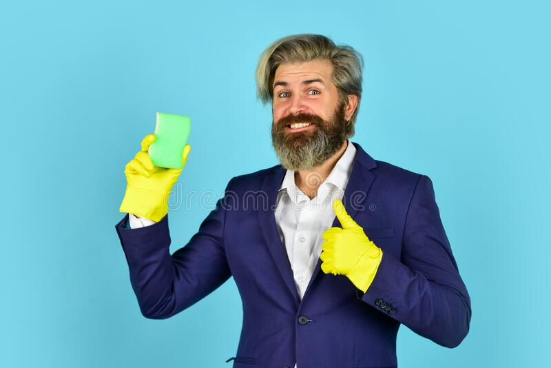 Virus disinfection. Man protective rubber gloves. Clean office. Destroy microorganisms. Disinfection concept. Bearded. Businessman. Spring cleaning. Hipster royalty free stock photo