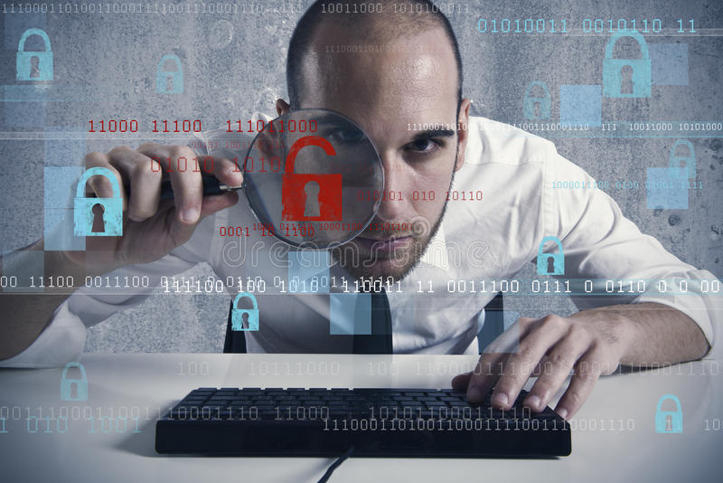 Virus and hacking concept. Businessman looking in a computer for virus and hacker