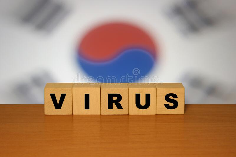 Virus message sign on a wooden desk on cube blocks with a South Korea flag background. Coronavirus. Concept royalty free stock image