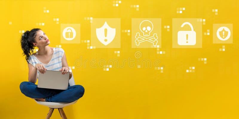 Virus- och svindeltema med kvinnan som använder en bärbar dator royaltyfri foto