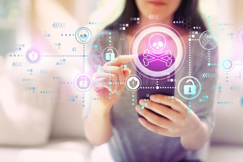 Virus and scam theme with woman using a smartphone royalty free stock photo