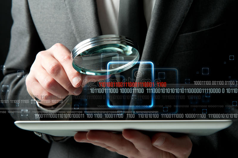 Virus search. Businessman looks for the malicious code of a virus royalty free stock image