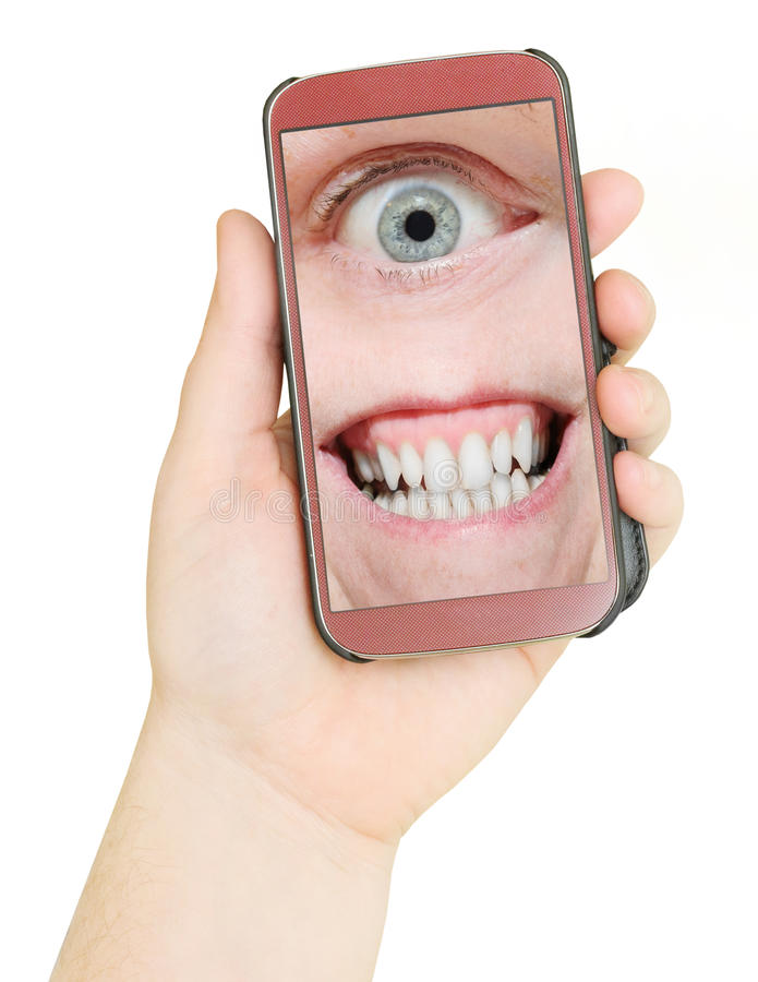 Virus in your phone. Mobile phone with eye and teeth. Big Brother is watching you. Internet safety concept royalty free stock photography