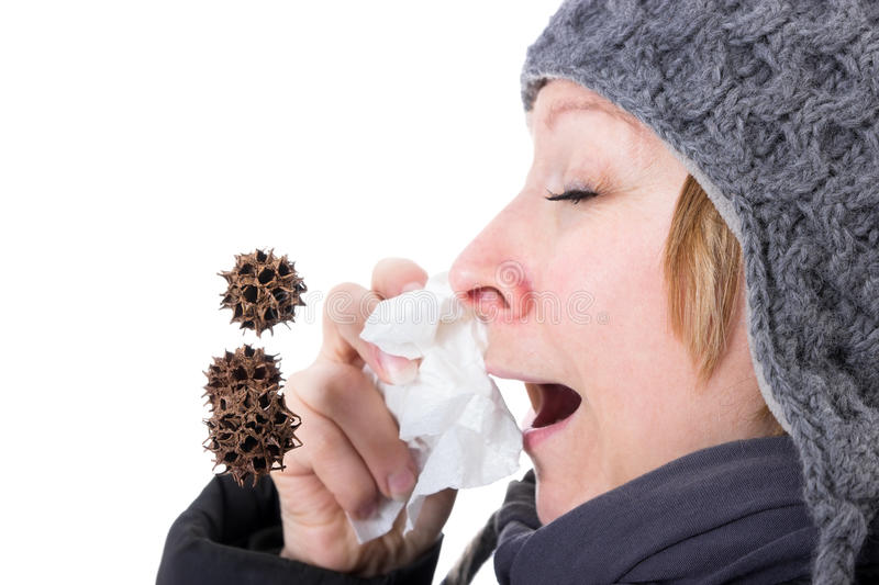 Viruses in the air. By a woman sneezing viruses and bacteria flying through the air royalty free stock photo
