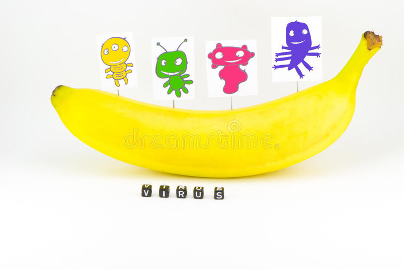 Viruses. On the background of banana royalty free stock image