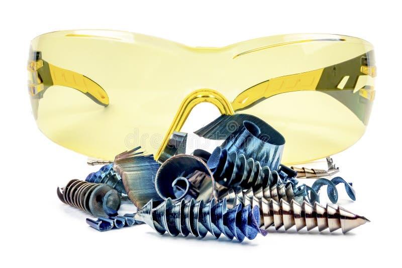 Virutas del metal en el fondo de gafas foto de archivo libre de regalías