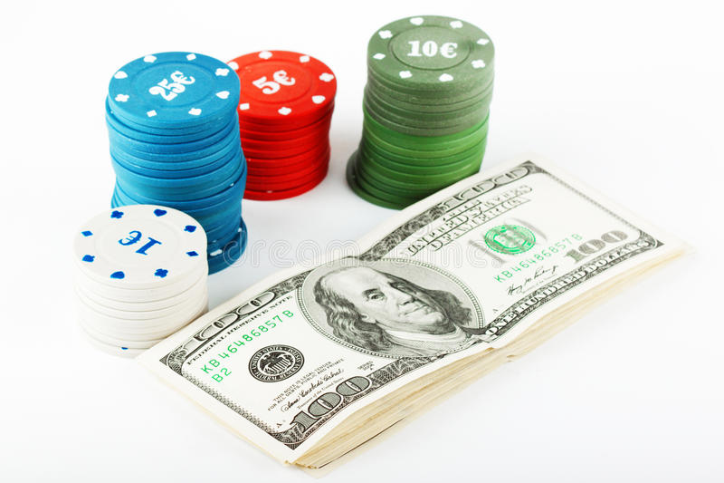 Virutas y dólares coloridos del casino fotografía de archivo libre de regalías