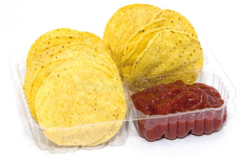Virutas y salsa de maíz imagenes de archivo