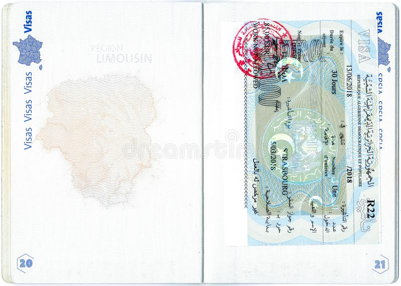Visa of Algeria in a French passport. Personal data removed royalty free stock image